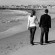 Couple-walking-on-beach-